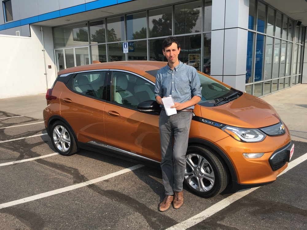 Andrew Kenney and a Chevrolet Bolt. (Andrew Kenney/Denverite)