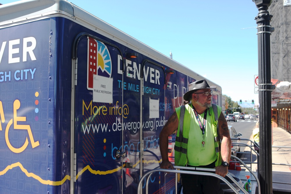 Paul Grogan, a restroom attendant, outside the city of Denver's portable bathroom unit on East Colfax. (Andrew Kenney/Denverite)