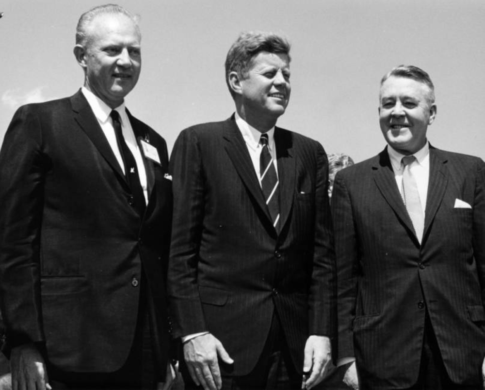 Colorado Gov. Stephen McNichols, President John F. Kennedy and U. S. Sen. John Carroll pose outdoors at the Pueblo Public School Stadium in Pueblo at the Presidential authorization of the Fryingpan - Arkansas Rivers water reclamation project, Aug. 17, 1962. (Ed Gerhardt/Western History & Genealogy Dept./Denver Public Library/X-22193)