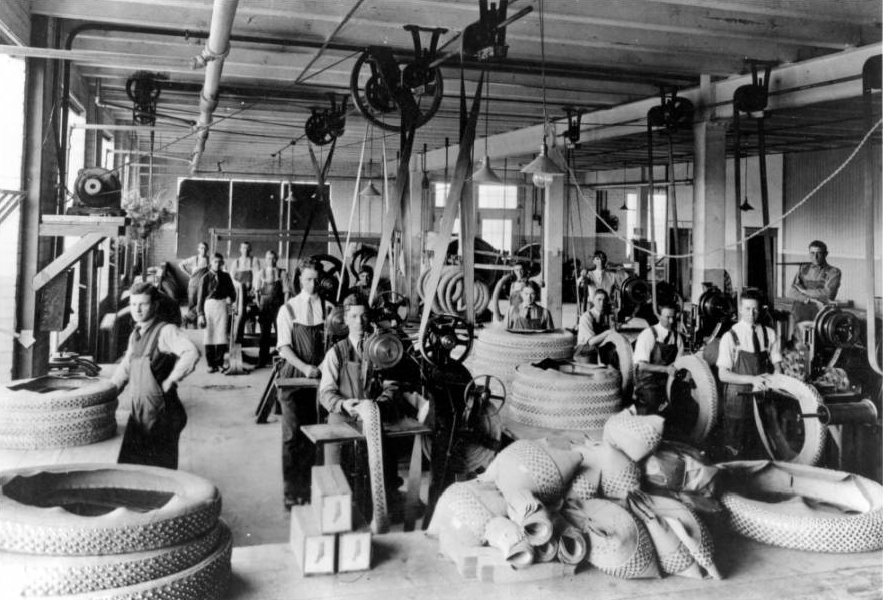Gates Rubber Co. workers stopped the humming machinery in the Denver factory to pose for this picture in 1917. (Rocky Mountain News/Denver Public Library/RMN-040-5223)