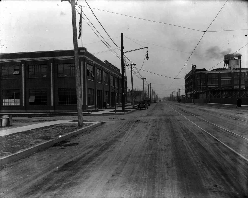 View of Broadway at Tennessee Avenue in Denver sometime between 1900 and 1920 with the Colorado Tire and Leather Co. on the left and Gates Rubber Co. on the right. (Harry Mellon Rhoads/Denver Public Library/Rh-1140)