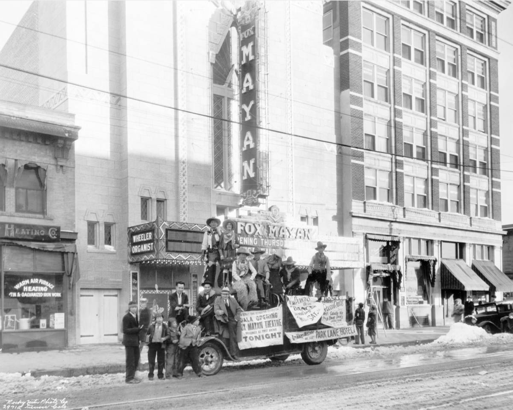 Men pose in November 1930 on a truck near the Mayan Theatre at 110 Broadway in the Speer neighborhood of Denver. (	Rocky Mountain Photo Co./Denver Public Library/X-24681)