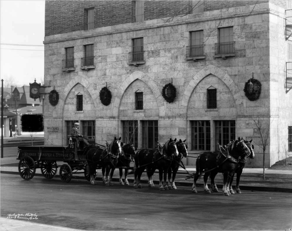 A man sits on a horse-drawn delivery wagon Jan. 23, 1928, on Colfax Avenue near Vine Street in the Cheesman Park neighborhood of Denver. (Rocky Mountain Photo Co./Denver Public Library/X-24433)