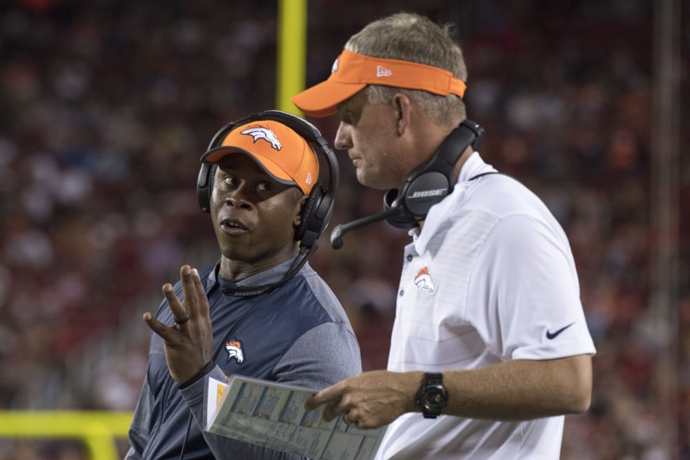 Denver Broncos head coach Vance Joseph (left) talks to offensive coordinator Mike McCoy (right) during the third quarter against the San Francisco 49ers at Levi's Stadium. The Broncos defeated the 49ers 33-14. August 19, 2017; Santa Clara, CA. (Kyle Terada/USA TODAY Sports)