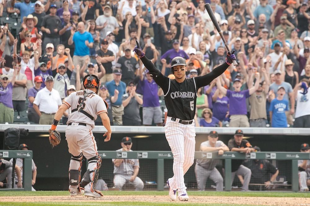 Carlos Gonzalez celebrates after a walk-off walk. ( Isaiah J. Downing/USA Today Sports)