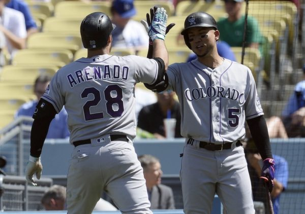 Nolan Arenado hit a solo homer and drove in another run in the Rockies' sweep Sunday. (Gary A. Vasquez/USA Today Sports)
