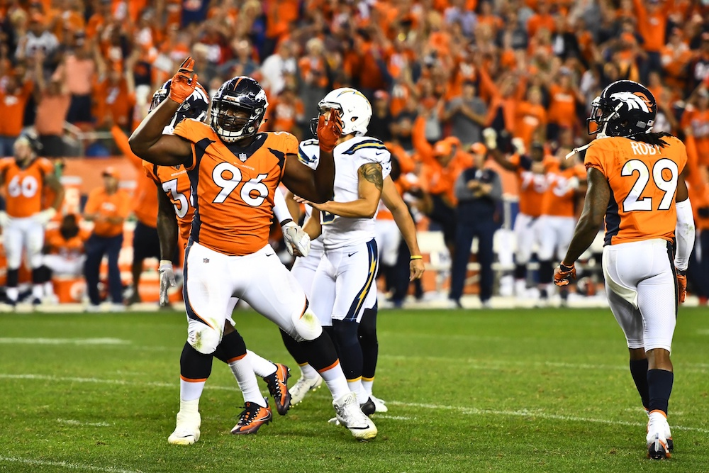 Shelby Harris' blocked FG preserved a 24-21 Broncos win. (Ron Chenoy/USA Today Sports)