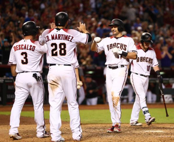 A.J. Pollock celebrates his three-run homer with J.D. Martinez and Daniel Descalso. (Mark J. Rebilas/USA Today Sports)