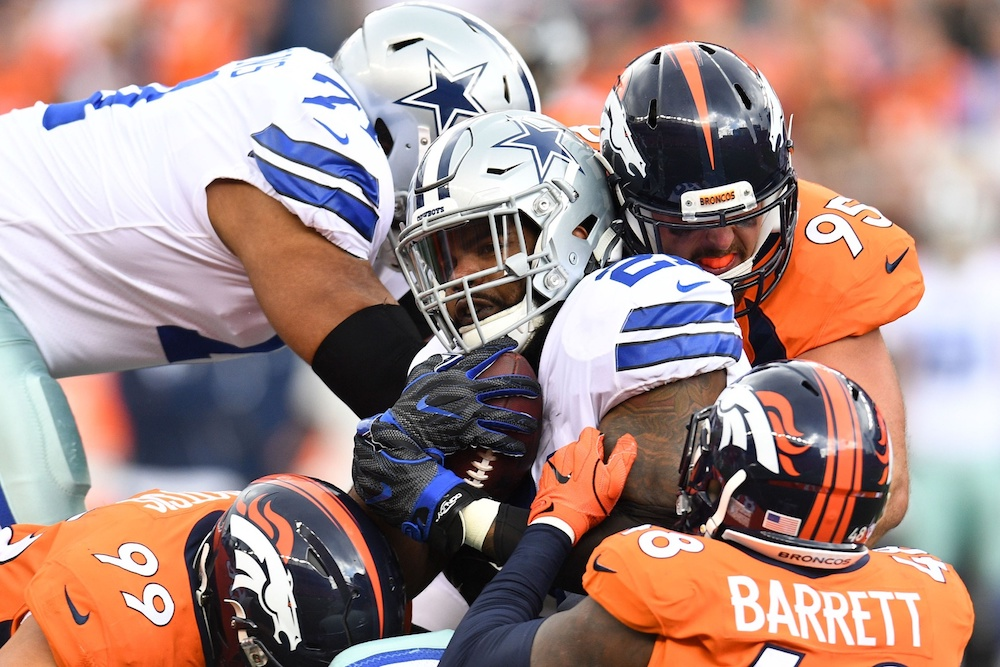 The Broncos limited the Cowboys to 40 rushing yards Sunday. (Ron Chenoy/USA Today Sports)