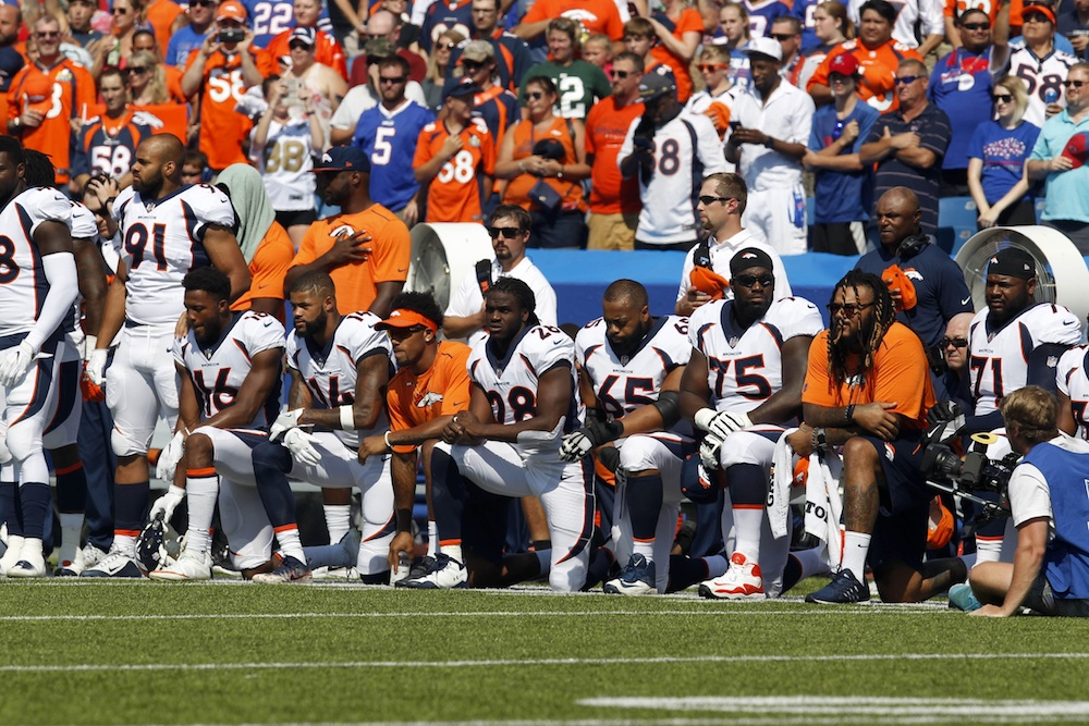 Thirty-two Broncos players kneeled Sunday. (Timothy T. Ludwig/USA Today Sports)