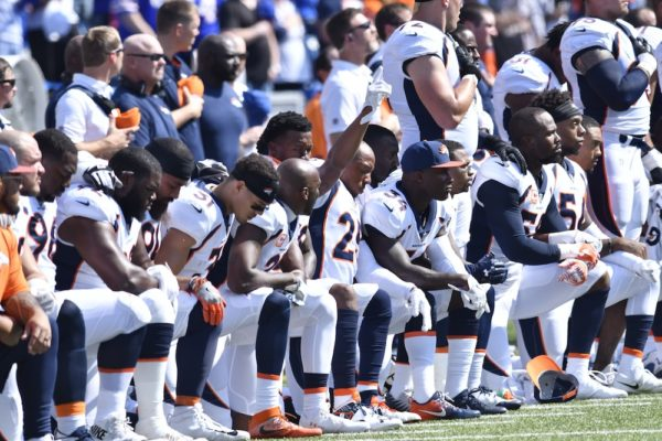 Most of the Broncos kneeled during the national anthem Sunday. (Mark Konezny/USA Today Sports)