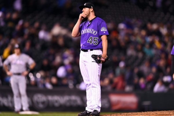 Scott Oberg reacts after loading the bases. (Ron Chenoy/USA Today Sports)