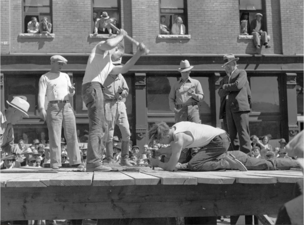 "Fred Dopp swings a sledge hammer during a ""hard rock drilling contest"" in Silverton on Labor Day in the 1930s. Fun! (Walker Art Studio/Western History & Genealogy Dept./Denver Public Library)"