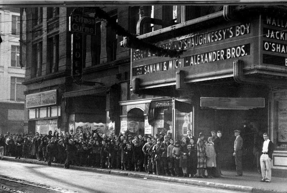 Kids and teenagers in line at the entrance of the old Tabor Theater on 16th Street on Christmas Eve, 1935. (Western History & Genealogy Dept./Denver Public Library/X-24746