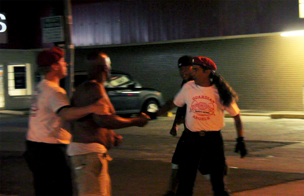 "Guardian Angels Peter Sleeves (left) and Tom ""Kukelkan"" Garcia break up a fight on East Colfax Avenue, Sept. 4, 2015. (Kevin J. Beaty)  denver; colorado; colfax; denverite; kevinjbeaty; guardian angels;"