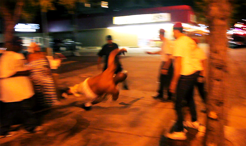 A man falls to the ground during a street fight on East Colfax Avenue, Sept. 4, 2017. (Kevin J. Beaty)  denver; colorado; colfax; denverite; kevinjbeaty; guardian angels;
