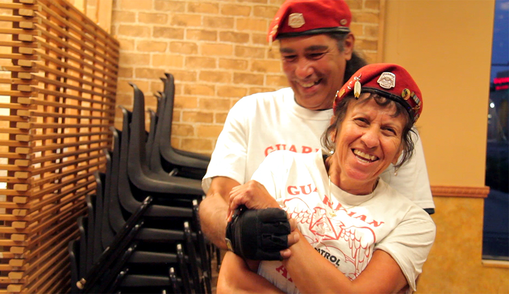 "Sally ""Apache"" Martinez and her husband, Tom ""Kukelkan"" Garcia, inside the Colorado Guardian Angels headquarters on East Colfax Avenue, Sept. 4, 2015. (Kevin J. Beaty)  denver; colorado; colfax; denverite; kevinjbeaty; guardian angels"