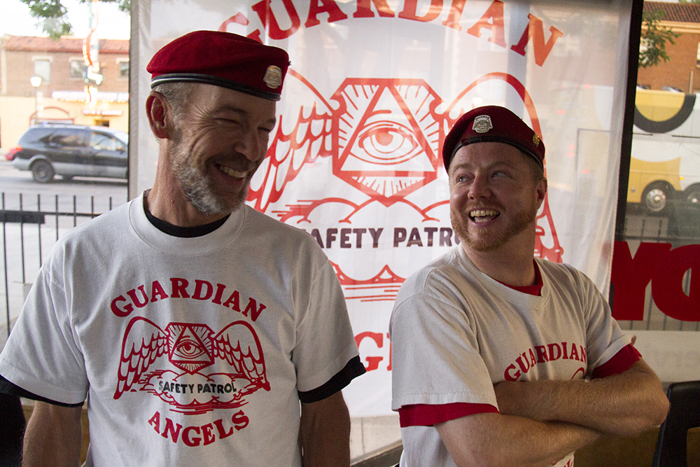 "Robi ""Wolf"" Salo (left) and Ryan ""Archangel"" Warren inside the Colorado Guardian Angel's most recent headquarters on Colfax Avenue, Aug. 14, 2017. (Kevin J. Beaty/Denverite)  denver; colorado; colfax; denverite; kevinjbeaty; guardian angels"