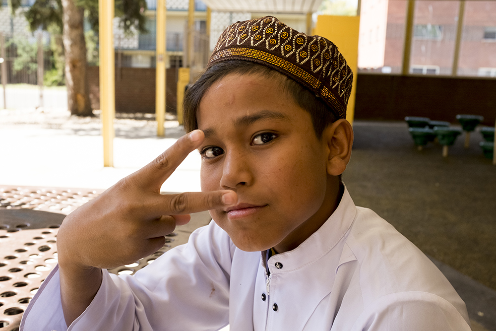 A young man named Sala poses for a portrait. Friday prayer for Aurora's Burmese Mulsim Rohingya community, Aug. 22, 2017. (Kevin J. Beaty/Denverite)  aurora; refugee; rohingya; burma; myanmar; kevinjbeaty; denverite; colorado;