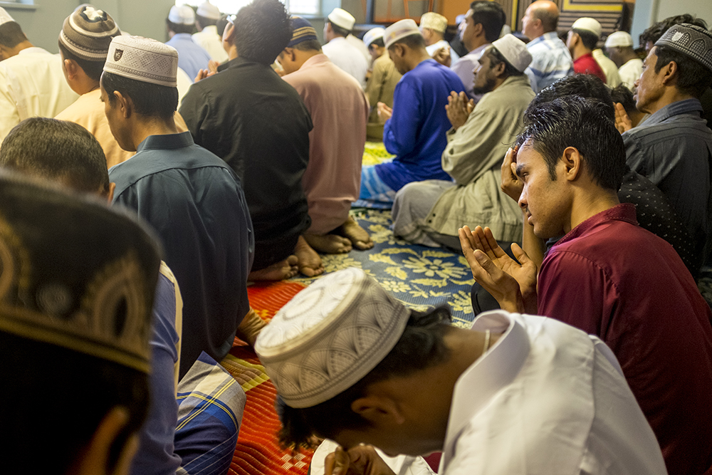 Mdosman Gani (right) during Friday prayer in a mosque inside of an apartment building largely inhabited by Aurora's Burmese Mulsim Rohingya community, Aug. 22, 2017. (Kevin J. Beaty/Denverite)