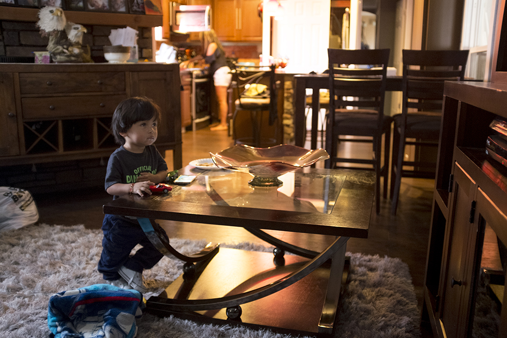 Ingrid Encalada's son, Anibal, watches TV at home, Sept. 12, 2017. (Kevin J. Beaty/Denverite)  ingrid encalada latorre; immigration; deportation; denver; denverite; colorado; undocumented; kevinjbeaty