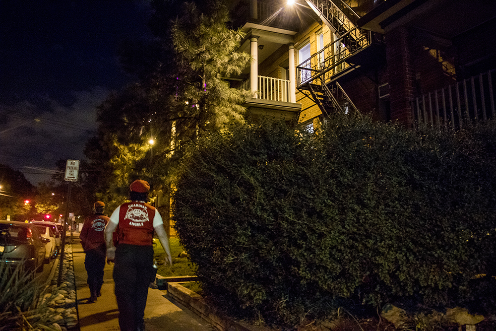 A Colorado Guardian Angels patrol passes by the group's first headquarters on Pearl Street at 14th Avenue. Sept. 16, 2017. (Kevin J. Beaty/Denverite)  denver; colorado; guardian angels; capitol hill; denverite; colfax; kevinjbeaty;