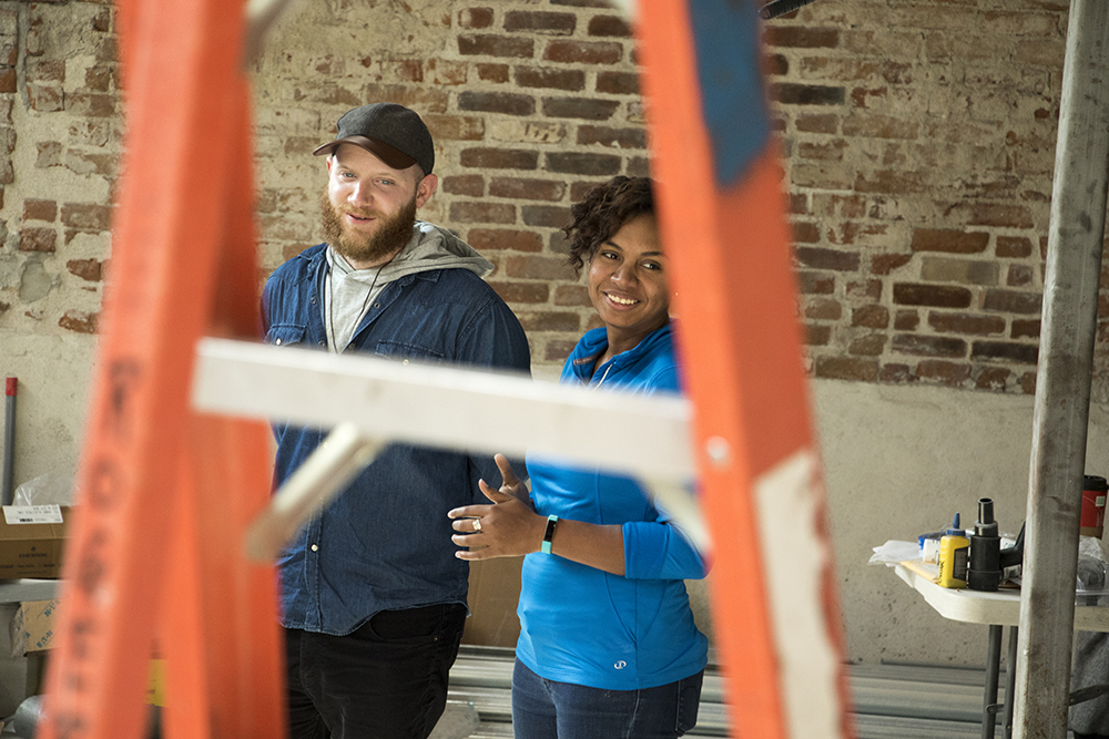 Novel Strand Brewing partners Tamir Danon and Chantel Columna inside the Baker neighborhood building that will soon house their business. They signed their lease moments later on Sept. 29, 2017. (Kevin J. Beaty/Denverite)