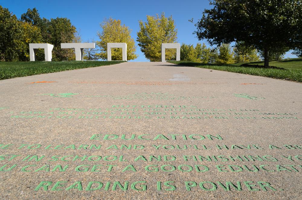 Inscriptions on the path leading to Northside Park (Austin Cope/For Denverite) parks; park; Northside Park; Globeville; sal carpio