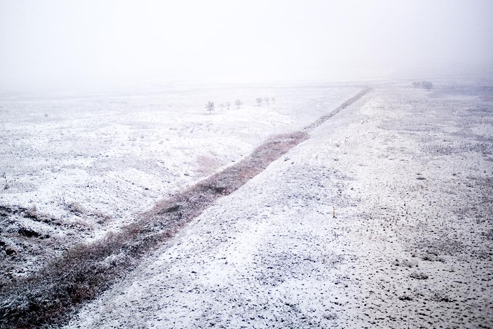 A snowy day, Oct. 9, 2017. (Kevin J. Beaty/Denverite)  snow; weather; cowx; denver; denverite; winter; kevinjbeaty; train; rtd; a line; colorado;
