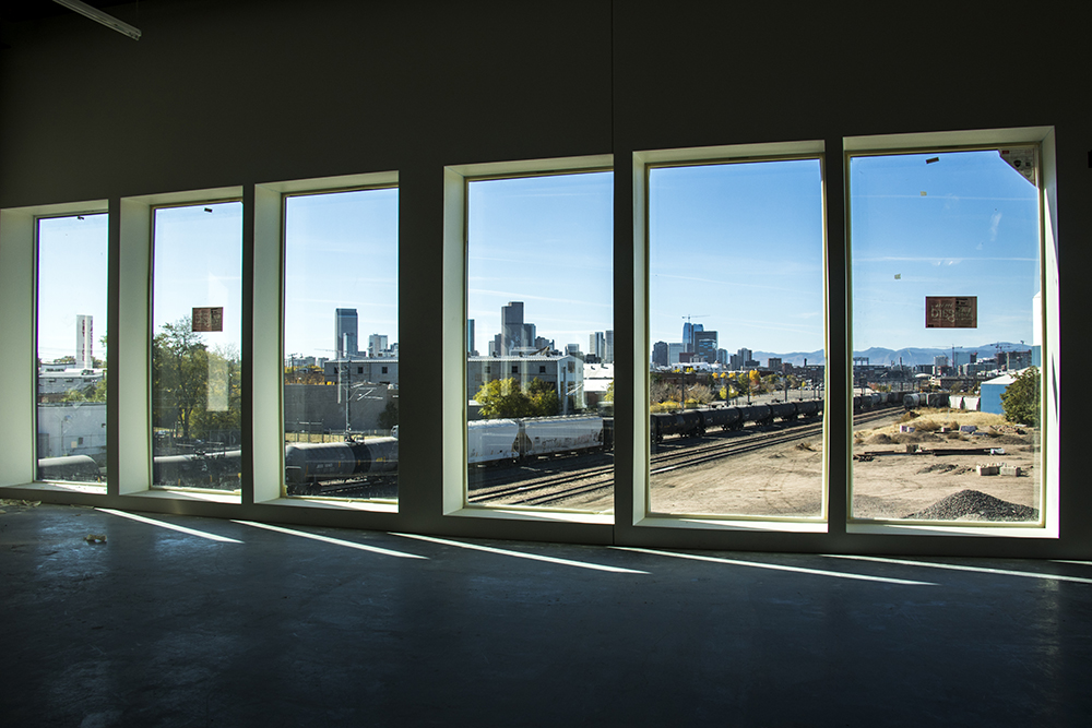 The Denver skyline, seen from  Zeppelin Station, which is still under construction, Oct. 17, 2017. (Kevin J. Beaty/Denverite)   denver; colorado; denverite; kevinjbeaty; development; construction; rino; five points; zeppelin station;