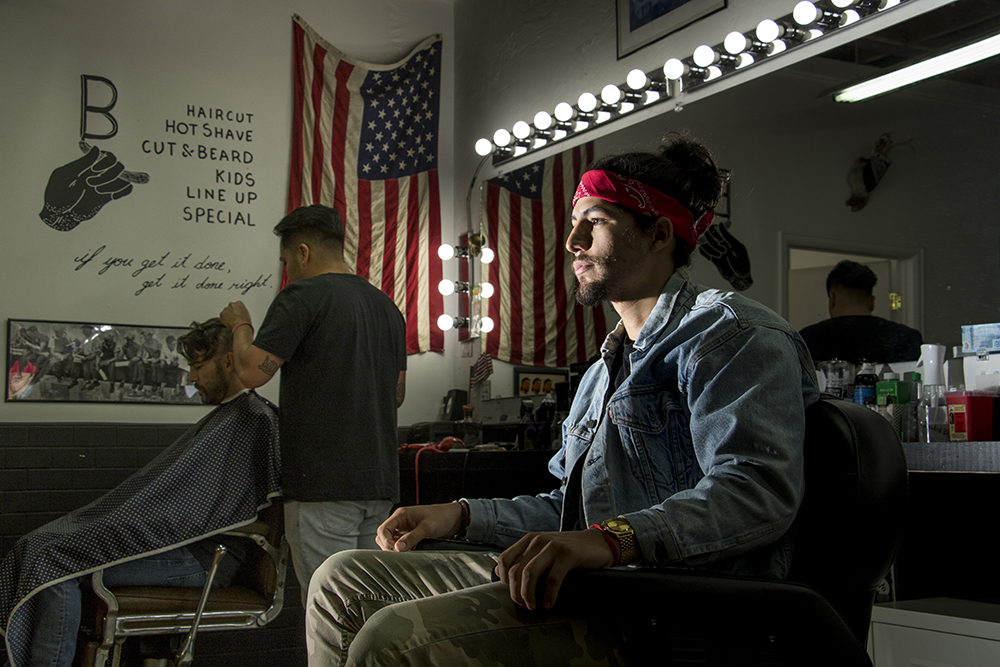 Sway the barber inside his shop inside Bellwether on East Colfax Avenue, Oct. 19, 2017. (Kevin J. Beaty/Denverite)  barber shop; bellwether; denver; colorado; hale; denverite; kevinjbeaty;