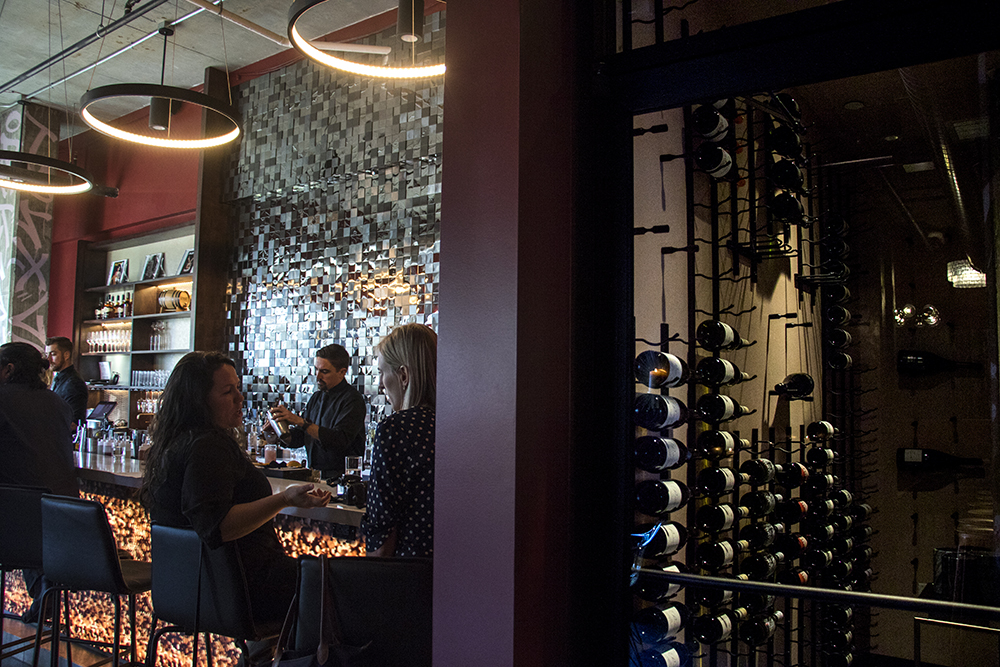 The bar and a wine room inside Bar Helix, Oct. 24, 2017. (Kevin J. Beaty/Denverite)  denver; colorado; denverite; kevinjbeaty; food; bars; nightlife; rino; five points;
