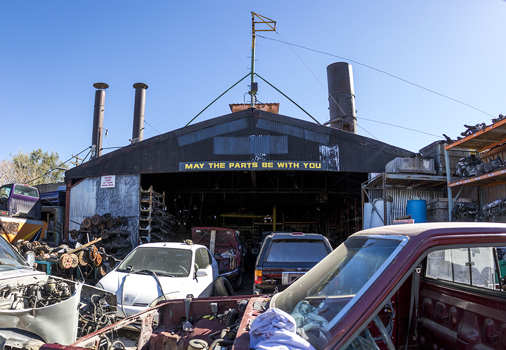 """May the parts be with you."" Yota Yard on Walnut Street, Five Points, Oct. 25, 2017. (Kevin J. Beaty/Denverite)  denver; colorado; denverite; rino; five points; development; kevinjbeaty; scrapyard;"