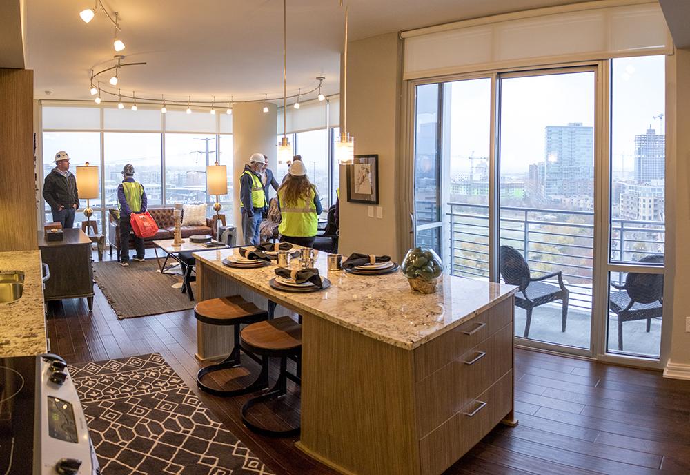 The Denver Architectural Foundation tours a two bedroom apartment inside  The Confluence Denver, Oct. 26, 2017. (Kevin J. Beaty/Denverite)  denver; colorado; denverite; kevinjbeaty; the confluence; development; residential real estate; high density housing; skyscraper;