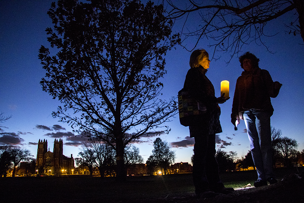 Christine O'Connor (left) and Bridget Walsh carry candles into City Park Golf Course to leave memorials for doomed trees, Oct. 29, 2017. (Kevin J. Beaty/Denverite)  city park golf course; protest; trees; denver; denverite; colorado; kevinjbeaty; skyland;