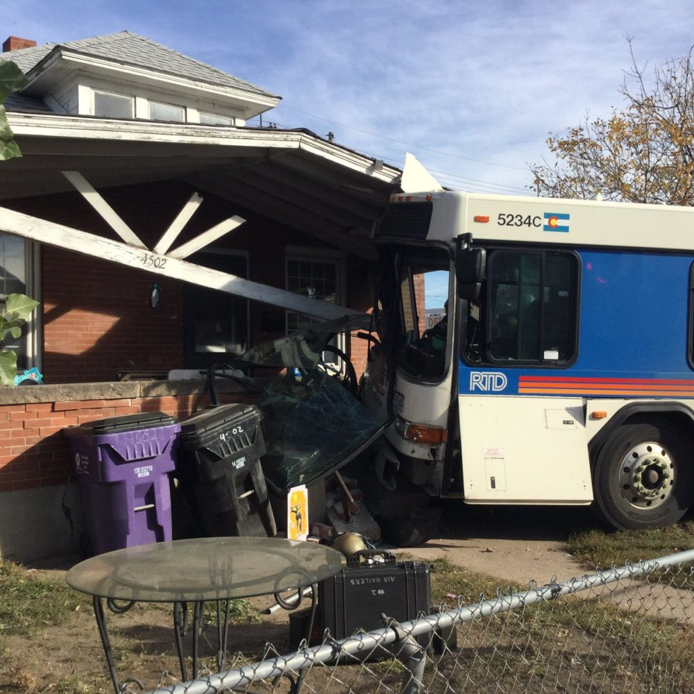 A bus and a house. (Denver Fire Department)