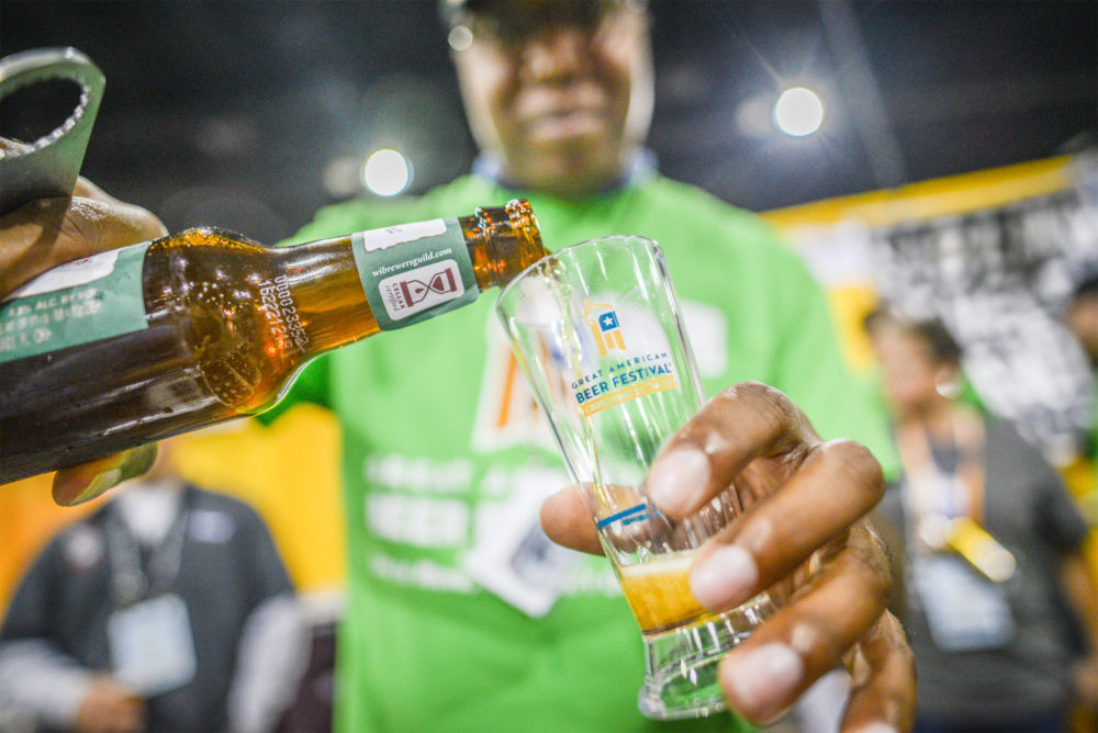 A volunteer pours a beer sample at the 2016 Great American Beer Festival in Denver. (Courtesy of Brewers Association)