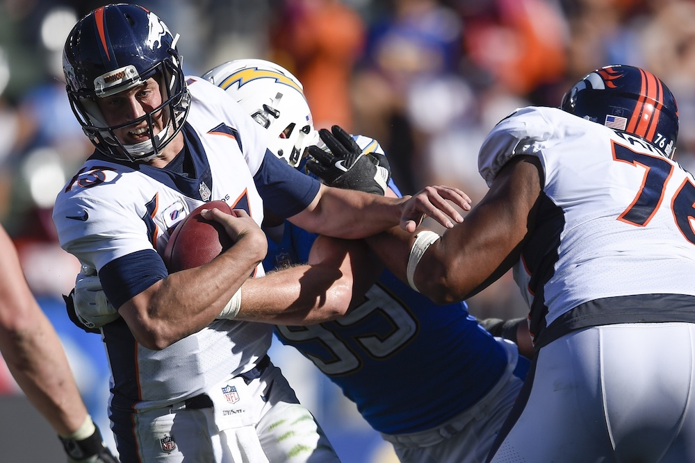 Trevor Siemian was sacked five times Sunday. (Kevin Kuo/USA Today Sports)