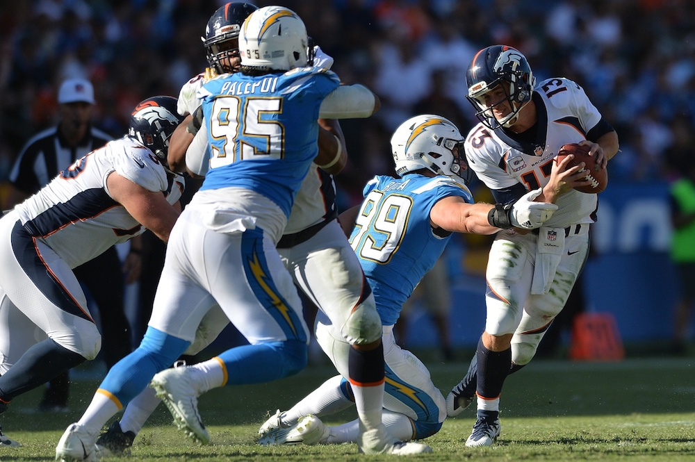 Trevor Siemian faced pressure all day Sunday in Los Angeles. (Orlando Ramirez/USA Today Sports)