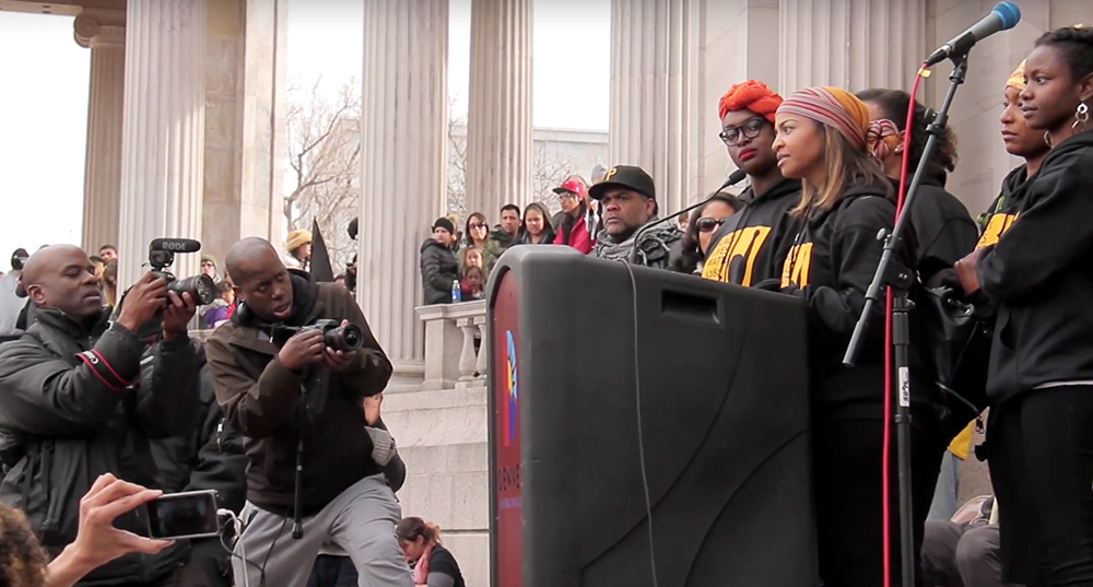 Black Lives Matter 5280 activist Amy E. Emery-Brown speaks at a podium meant for Marade programming on Jan. 18, 2016. (Kevin J. Beaty)