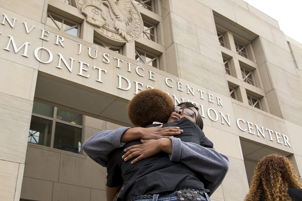 Natalia Marshall hugs Rev. Dr. Dawn Riley Duval after the press conference. Michael Marshall's family and their lawyers announce they've made a $4.65 million settlement with the city following his death in jail, Nov. 1, 2017. (Kevin J. Beaty/Denverite)   michael marshall; denver justice center; denver; colorado; denverite; kevinjbeaty;