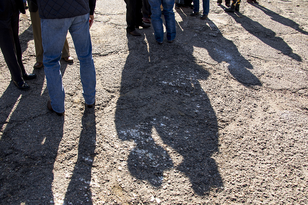 Cowboy hats and boots at the groundbreaking for the National Western Center at the old International Paper building in Elyria Swansea, Nov. 3, 2017. (Kevin J. Beaty/Denverite)  denver; colorado; denverite; kevinjbeaty; national western center; development; elyria swansea; construction;