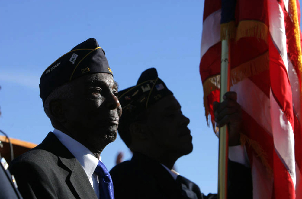 Norman Harris, 90, stands with the other members of the Wallace Simpson American Legion Post 29 in Five Points before the start of the annual Martin Luther King Day Marade in Denver on Monday January 19, 2009. Harris is a WWII and Korean War veteran. (Darin McGregor/Rocky Mountain News/Denver Public Library/Western History Collection/RMN-056-0492)