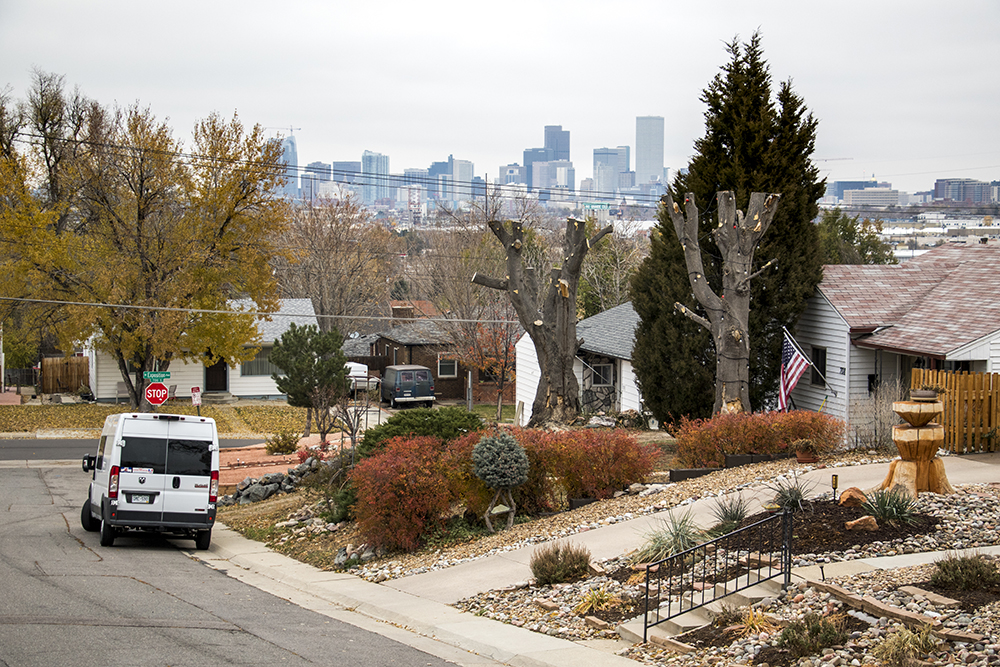 The Denver skyline seen beyond an Athmar Park home. (Kevin J. Beaty/Denverite)  kevinjbeaty; denverite; denver; colorado; athmar park; residential real estate;