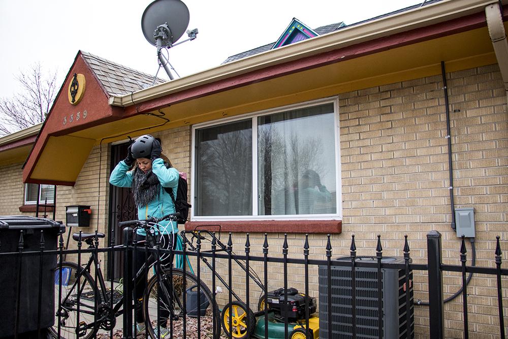 Alana Romans gets ready to head to work, Nov. 9, 2017. (Kevin J. Beaty/Denverite)  housing; highland; cost burdened renter; denver; denverite; colorado; kevinjbeaty;