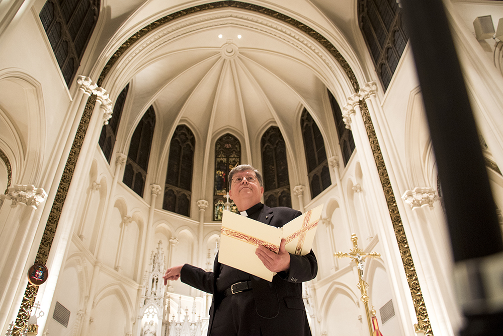 Rev. Ronald Cattany speaks about the Cathedral Basilica of the Immaculate Conception's history. (Kevin J. Beaty/Denverite)   Cathedral Basilica of the Immaculate Conception; catholic; church; religion; kevinjbeaty; denverite; colorado; denver; north capitol hill;