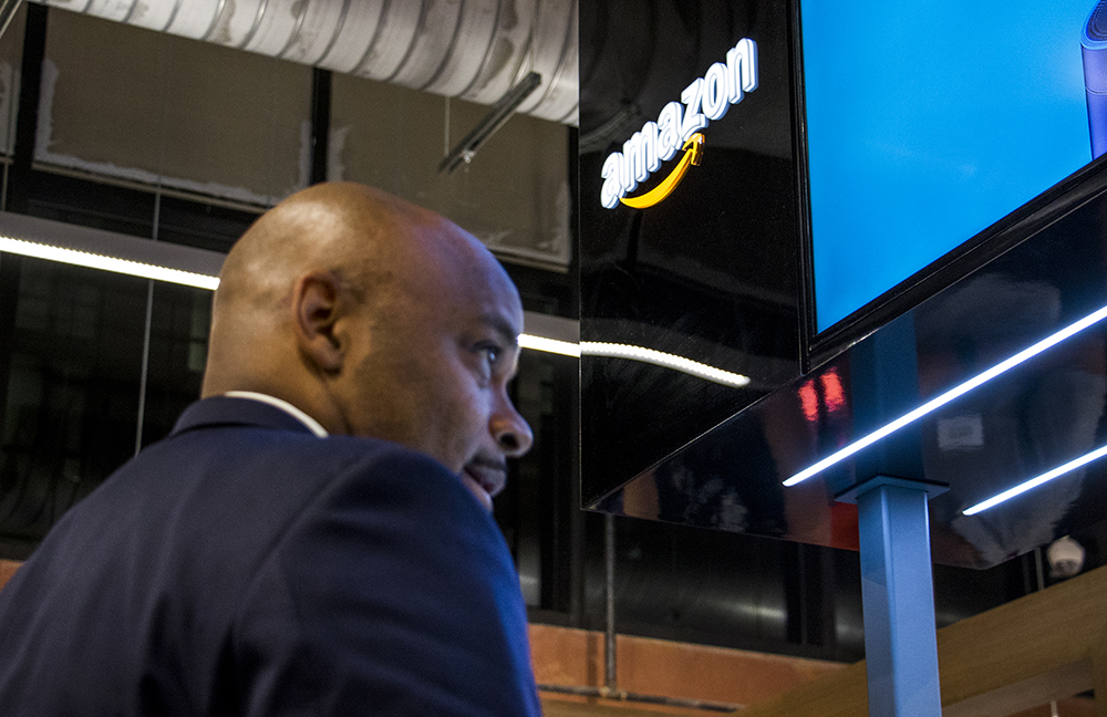 Mayor Michael Hancock tours an Amazon pop-up store inside the new Whole Foods Market near Union Station, Nov. 13, 2017. (Kevin J. Beaty/Denverite)  whole foods; grocery store; union station; denver; denverite; kevinjbeaty; colorado; mayor michael hancock;