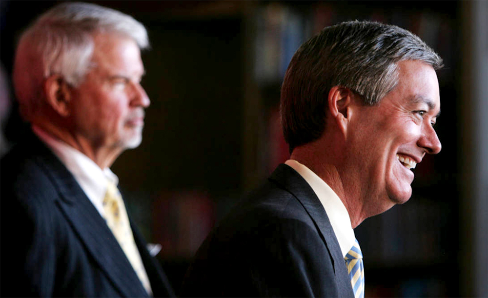 Former Colorado Gov. Bill Owens, right, laughs during a news conference in Denver on Wednesday afternoon, Jan. 24, 2007 announcing that he is joining the University of Denver as a senior fellow. (Joe Mahoney/Rocky Mountain News/Denver Public Library/Western History Collection/RMN-032-9117)  copolitics; governor bill owens; denver; colorado;