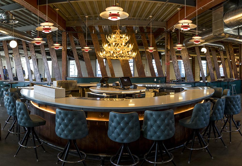 An antler chandelier above a 360-degree bar. Punch Bowl Social Stapleton days before its grand opening, Nov. 15, 2017. (Kevin J. Beaty/Denverite)  denver; colorado; denverite; kevinjbeaty; punch bowl social; stapleton; food; restaurant; nightlife; bar;
