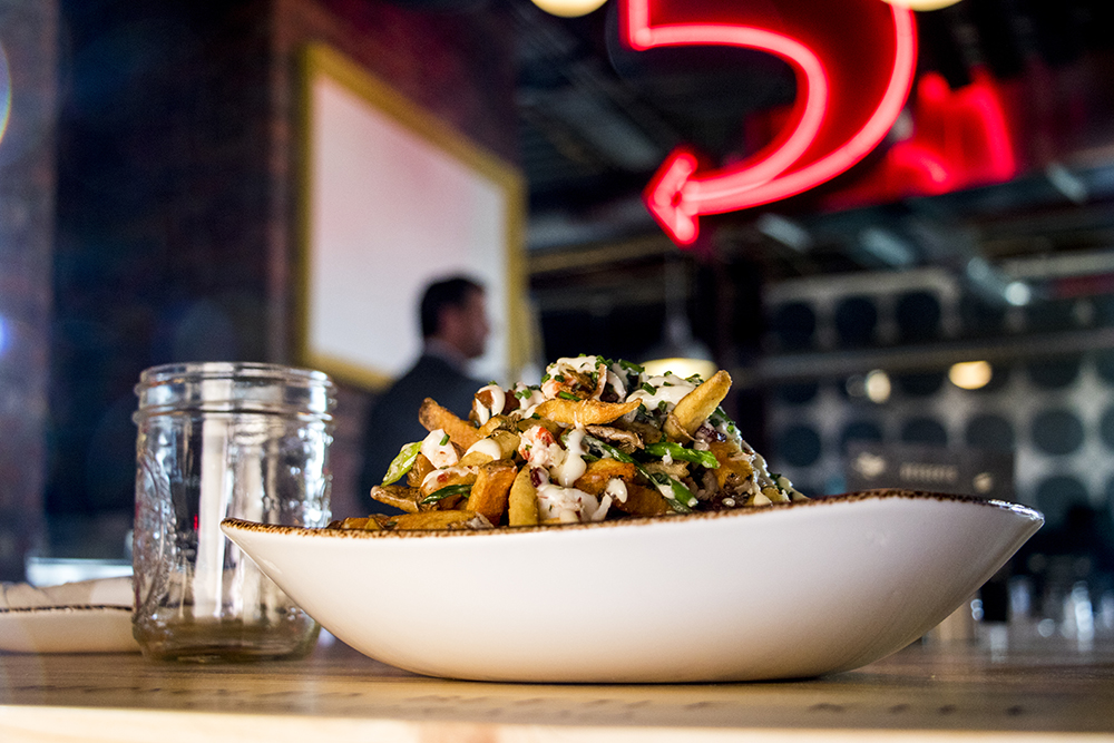 Lobster bacon fries. Punch Bowl Social Stapleton days before its grand opening, Nov. 15, 2017. (Kevin J. Beaty/Denverite)  denver; colorado; denverite; kevinjbeaty; punch bowl social; stapleton; food; restaurant; nightlife; bar;